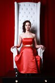 picture of throne  - princess woman in a red dresssitting on throne - JPG