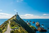 stock photo of lighthouse  - Lighthouse on Nugget Point - JPG