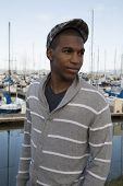 image of newsboy  - black male model wearing sweater newsboy hat - JPG