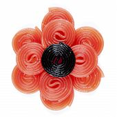 pic of licorice  - a black licorice wheel on some red licorice wheel on a white background - JPG