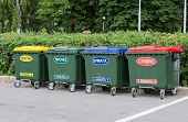 image of dumpster  - Green dumpsters on a city street with inscription on russian - JPG
