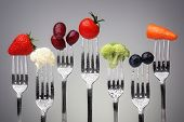 image of fruits  - Fruit and vegetable of silver forks against a grey background concept for healthy eating - JPG