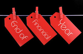 pic of pegging  - End of Financial Year red ticket sale tags hanging from pegs on a line against a black background - JPG