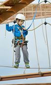 picture of 7-year-old  - 7 year old boy enjoying a challenging rope course sky trail in the Andorra Pyrenees Mountains - JPG