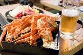 stock photo of cooked crab  - king crab legs and a glass of beer - JPG