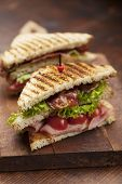 stock photo of tomato sandwich  - ham and bacon club sandwich on a white background - JPG
