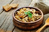 picture of porridge  - barley porridge with mushrooms on a dark wood background - JPG
