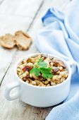 stock photo of porridge  - barley porridge with mushrooms on a white wood background - JPG