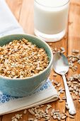 picture of porridge  - Oatmeal porridge and glass of milk on white wooden table - JPG
