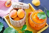 pic of apricot  - fresh apricot and jam in glass bank on a table - JPG