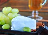foto of brie cheese  - camembert cheese with green grape on the wooden board - JPG