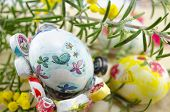 foto of decoupage  - Hand painted decoupage Easter eggs on decorated with green plant  - JPG