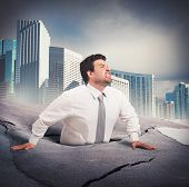 pic of quicksand  - Businessman sinks into despair of business failure - JPG