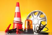 image of rectifier  - car accessories and road emergency items n yellow background - JPG