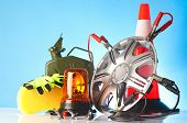 image of rectifier  - car accessories and road emergency items on blue background - JPG