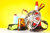 stock photo of rectifier  - road emergency items and car accessories on yellow background - JPG