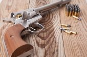 image of revolver  - A revolver on a piece of wood - JPG