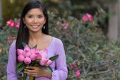 image of desert-rose  - Asian woman with lotus flowers bud posing in front of a desert rose tree - JPG