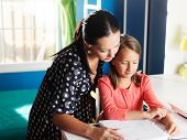 picture of homework  - mother and daughter doing homework together - JPG