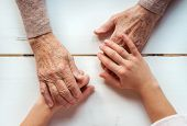 foto of granddaughters  - Unrecognizable grandmother and her granddaughter holding hands - JPG