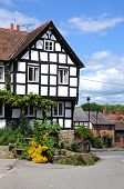 stock photo of timber  - Traditional white timbered building in the Market Place Pembridge Herefordshire England UK Western Europe - JPG
