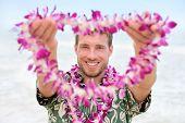stock photo of hawaiian flower  - Hawaii Caucasian man with welcome Hawaiian lei - JPG