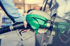 stock photo of fuel pump  - Pumping gas at gas station - JPG