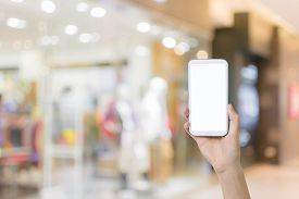 stock photo of department store  - Using smartphone in a market or department store - JPG