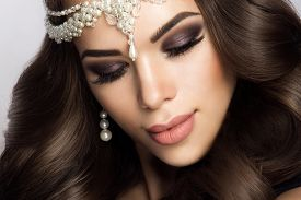 stock photo of wedding  - Beautiful bride with wedding makeup and hairstyle - JPG