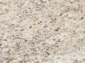 image of slab  - light beige mottled granite stone with brown and gray streaks in a large heavy slab - JPG