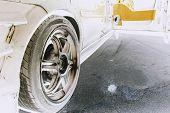 stock photo of barrel racing  - tuned car alloy wheel rim ready to race - JPG