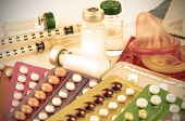 picture of oral  - Vintage tone Contraception Education Concept with Oral contraceptive Emergency Pills Injection Contraceptive and Male Condom - JPG