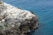 stock photo of extend  - Rocky Coast Extending into the Blue Sea - JPG