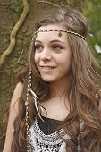stock photo of hippy  - Teenage girl styled in a hippy look smiling - JPG
