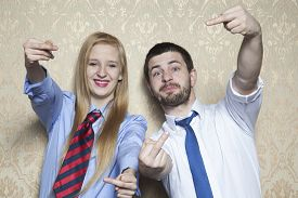 stock photo of sarcastic  - man and woman working together in the office - JPG