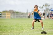 young preteen boy playing softball on outdoor background poster