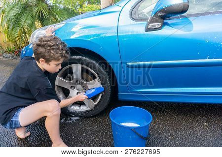 Boy Earning Pocket Money Cleaning