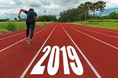 The Start Into The New Year 2019. Start Up Of Runner Man Running On Race Track Go To Goal Of Success poster