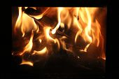 A Fire Burns In A Fireplace.  Burning Logs In A Fireplace. Fire Burning In The Night. - Image poster