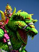 picture of godzilla  - A carnival float depicting a dragon lizard dinosaur - JPG