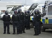pic of truncheon  - Uk welsh police officers in full riot gear at the scene of a public disturbance - JPG
