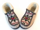 stock photo of budge  - The budge hand made knitted slipper swith ornate - JPG