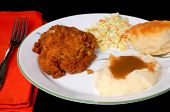 stock photo of biscuits gravy  - Dinner setting of fried chicken mashed potatoes with brown gravy roll and coleslaw - JPG