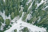 Overhead View Of Suv Car In Snowed Winter Forest. Travel Concept poster