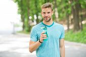 Sip Of Freshness After Great Workout. Man With Athletic Appearance Holds Bottle With Water. Athlete  poster