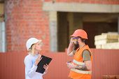 Woman Engineer And Bearded Brutal Builder Discuss Construction Progress. Construction Industry Conce poster