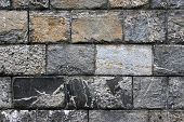 foto of fieldstone-wall  - Old grunge stone wall close up photo - JPG
