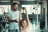 Beautiful Sexy Woman In Fitness Gym Training With Fitness Equipment In Sport Gym And Many Bodybuildi poster