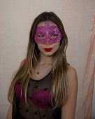 Portrait Of A Beautiful Young Woman With Venetian Carnival Red Mask. Glamorous Girl With Perfect Mak poster