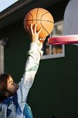 girl slam dunks basketball